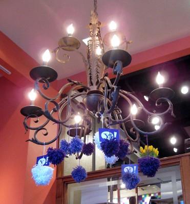 chandelier with Yahoo yarn bomb pom poms