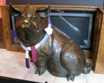 bronze pigs look better with scarves and pom pom earrings.