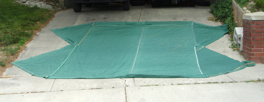 Here's my tent canvas spread out on my parent's driveway. Obviously not the same shape as a toga, but I think you get the point.